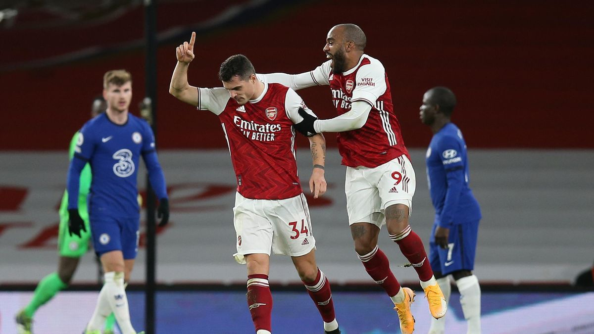 Granit Xhaka of Arsenal celebrates scoring their 2nd goal with Alexandre Lacazette who scored their 1st during the Premier League match between Arsenal and Chelsea at Emirates Stadium on December 26, 2020 in London, United Kingdom.