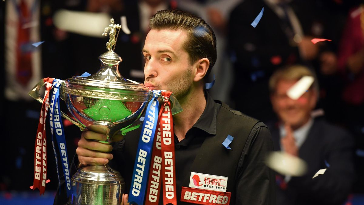England's Mark Selby kisses the trophy after beating Scotland's John Higgins in the World Championship Snooker final at The Crucible in Sheffield