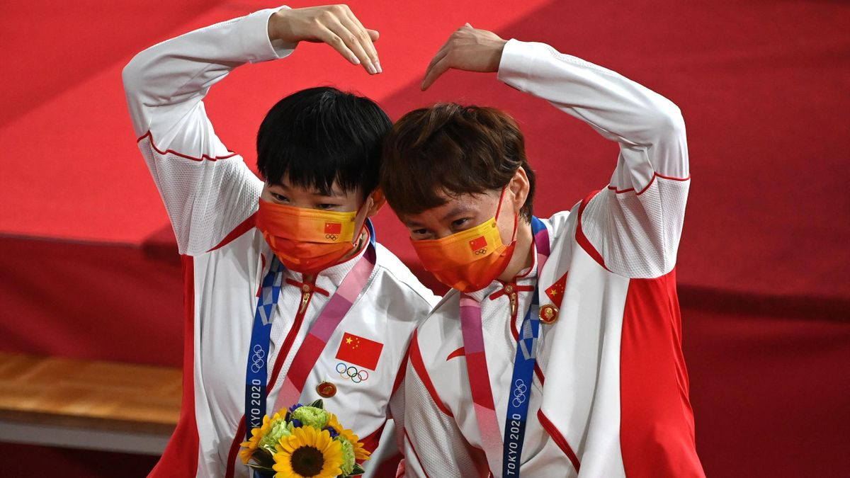 Gold medallists China's Bao Shanju (L) and China's Zhong Tianshi pose with their medals on the podium after the women's track cycling team sprint finals during the Tokyo 2020 Olympic Games at Izu Velodrome in Izu, Japan, on August 2, 2021