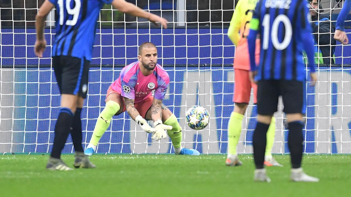 Kyle Walker of Manchester City makes a save while he is in goal for Claudio Bravo of Manchester City who was shown the red card during the UEFA Champions League group C match between Atalanta and Manchester City at Stadio Giuseppe Meazza on November 06, 2