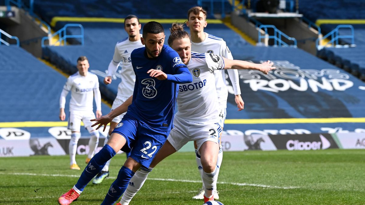 Hakim Ziyech of Chelsea is challenged by Luke Ayling of Leeds United during the Premier League match between Leeds United and Chelsea at Elland Road on March 13, 2021 in Leeds, England.