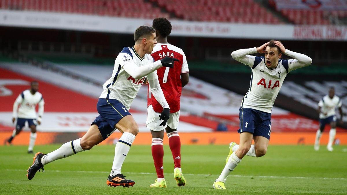 Erik Lamela of Tottenham Hotspur celebrates with team mate Sergio Reguilon