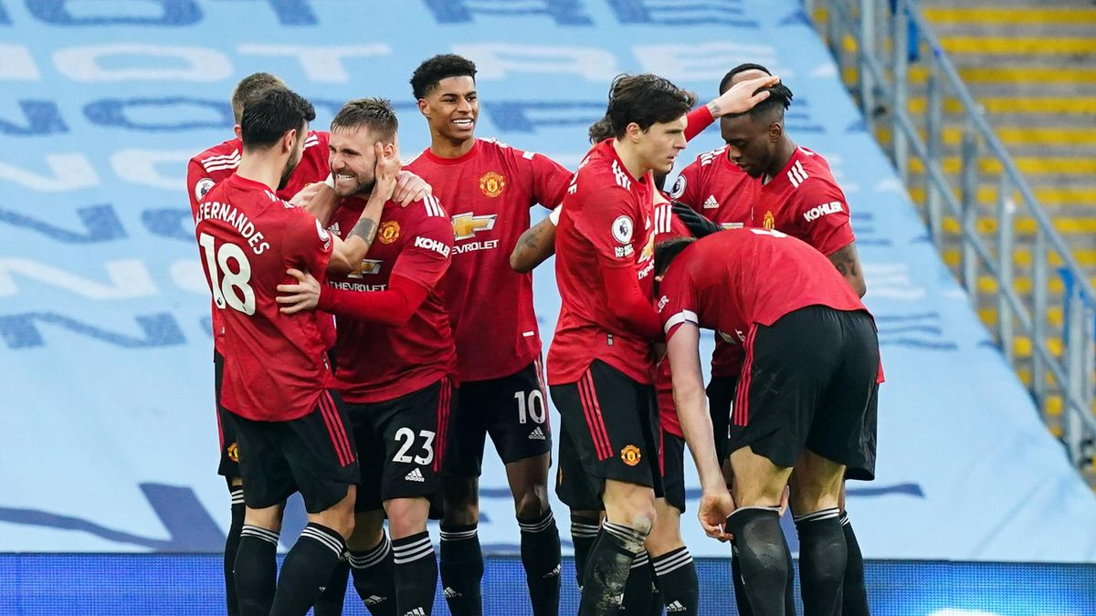 Luke Shaw of Manchester United celebrates with teammates after scoring his teams second goal during the Premier League match between Manchester City and Manchester United at Etihad Stadium
