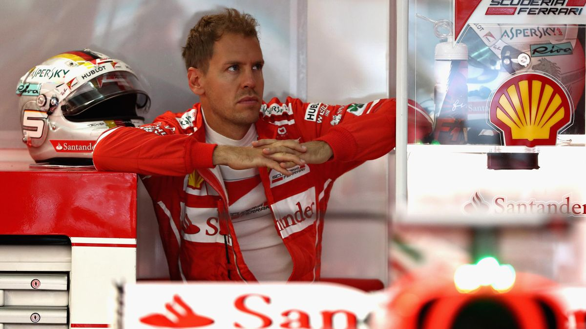 Sebastian Vettel of Germany and Ferrari looks on from the garage during practice for the Malaysia Formula One Grand Prix at Sepang Circuit on September 29, 2017 in Kuala Lumpur, Malaysia.