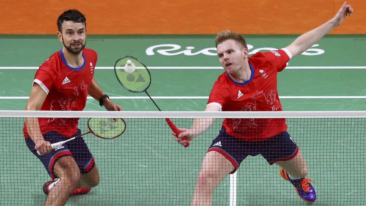 Chris Langridge (GBR) of Britain and Marcus Ellis (GBR) of Britain play against Kim Ki-Jung (KOR) of South Korea and Kim Sa-Rang (KOR) of South Korea.