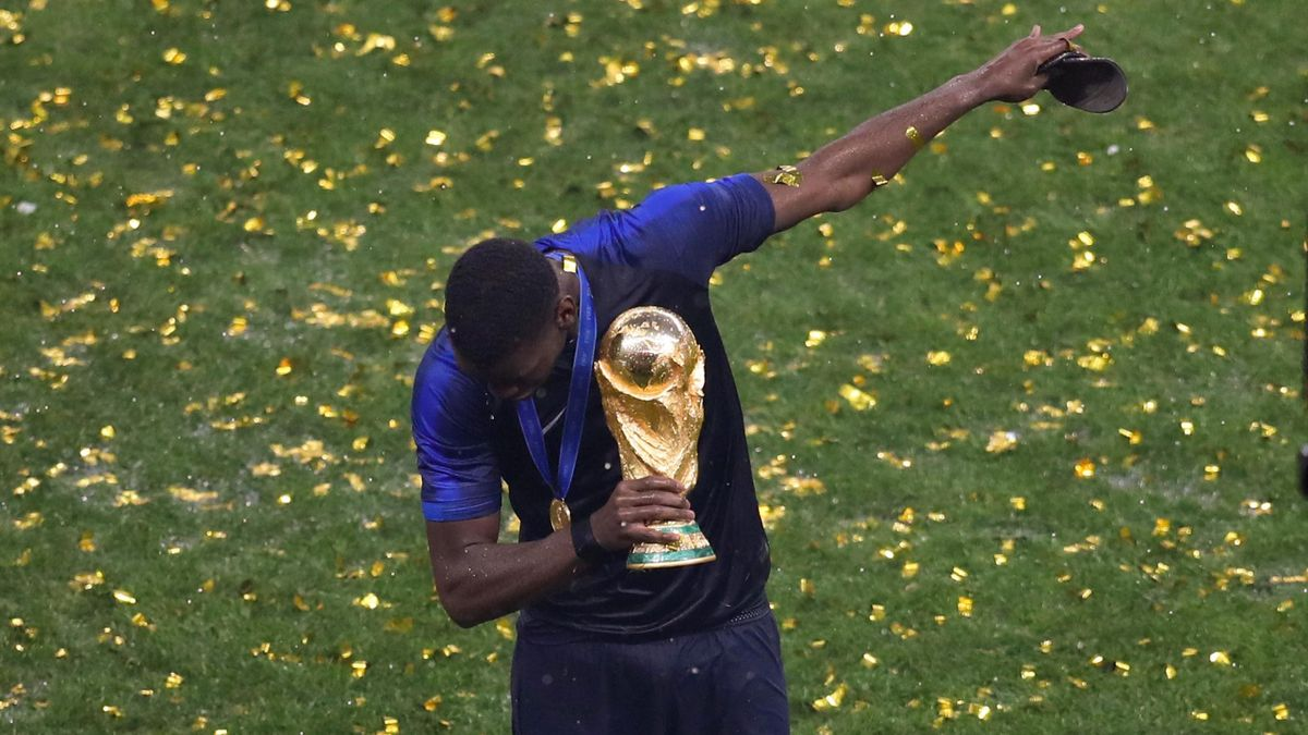 Paul Pogba of France dabs as he celebrates with the trophy after the 2018 FIFA World Cup Russia Final between France and Croatia at Luzhniki Stadium on July 15, 2018 in Moscow, Russia