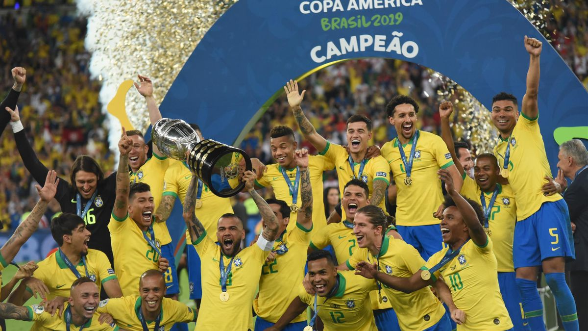Brazil team celebrate with the trophy after winning the final match of the Conmebol America Cup