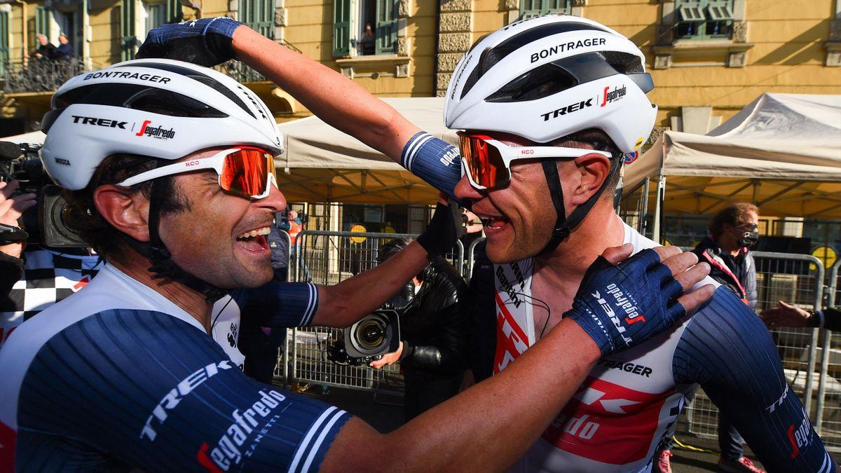 Team Trek rider Italy's Jacopo Mosca (L) congratulates Team Trek rider Belgium's Jasper Stuyven