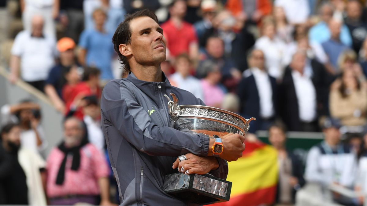 Rafael Nadal cradles his 12th French Open trophy