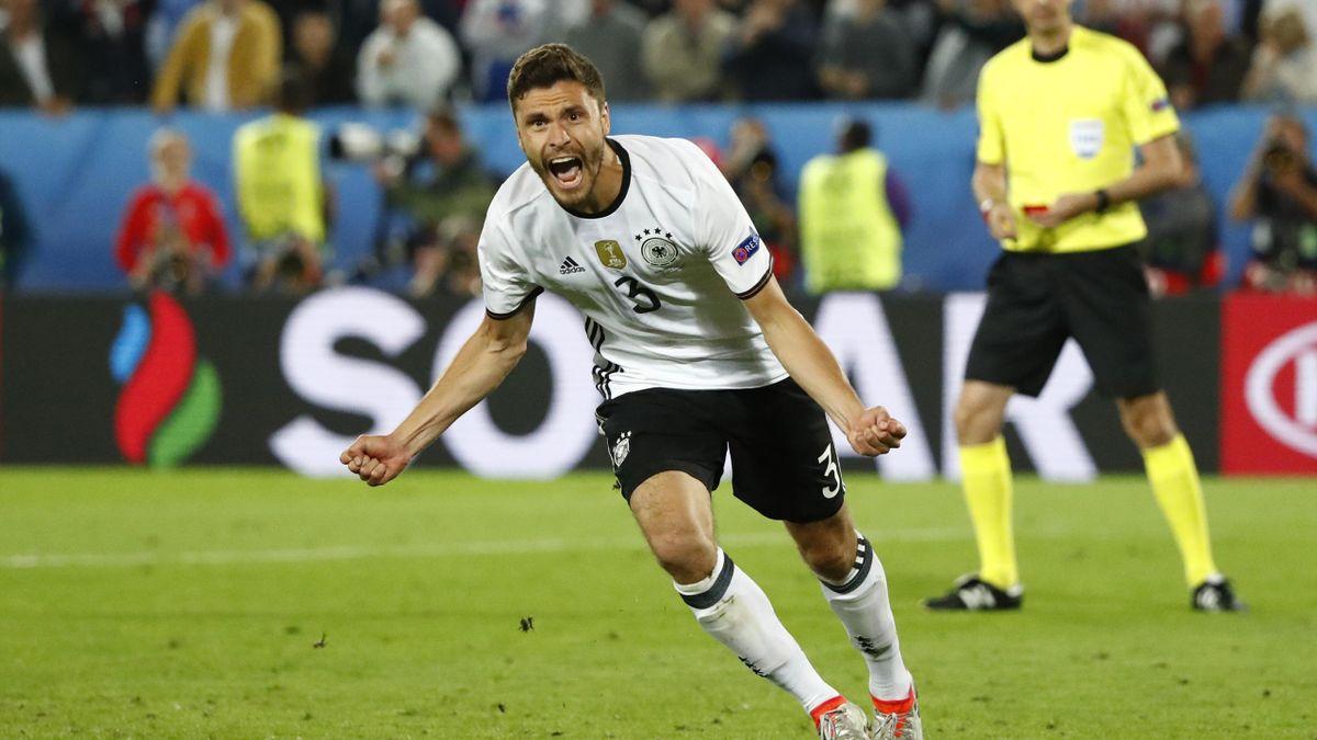 Germany's Jonas Hector celebrates scoring in the penalty shootout