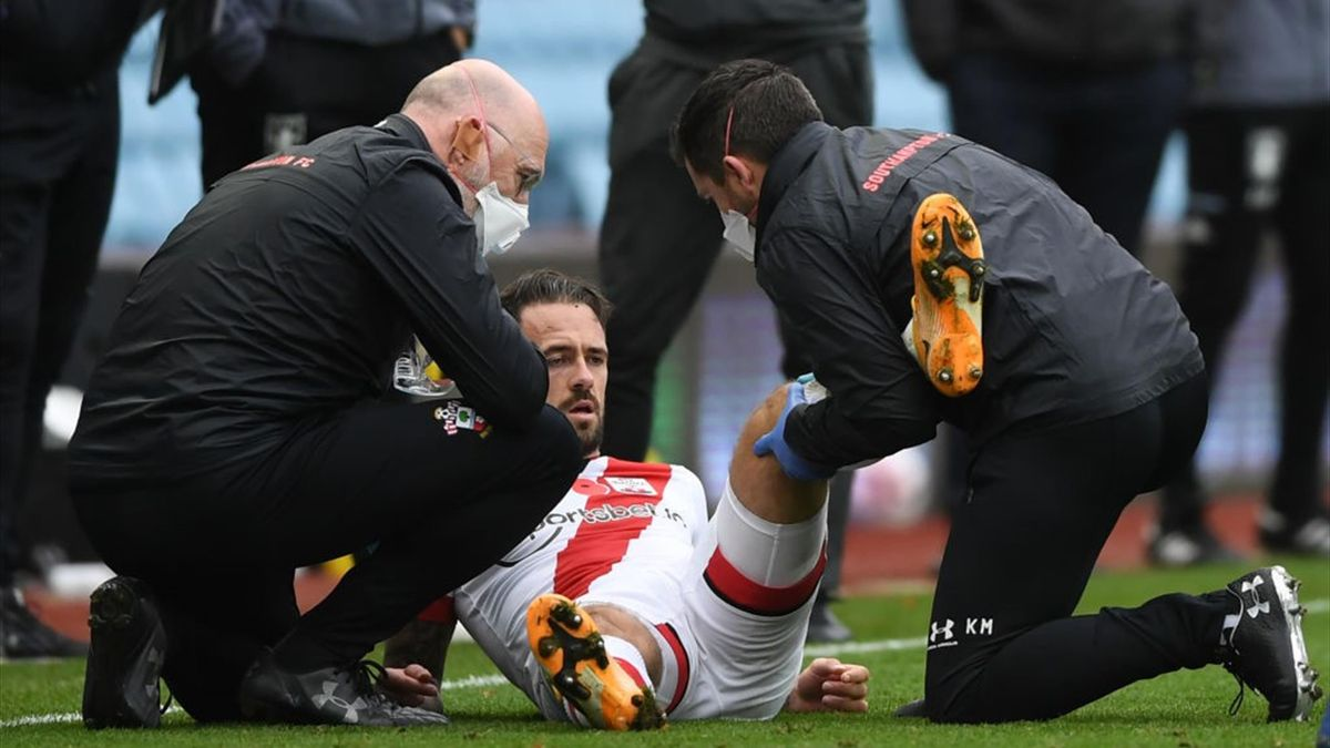 Southampton's English striker Danny Ings receives medical attention during the English Premier League football match between Aston Villa and Southampton at Villa Park in Birmingham, central England on November 1, 2020