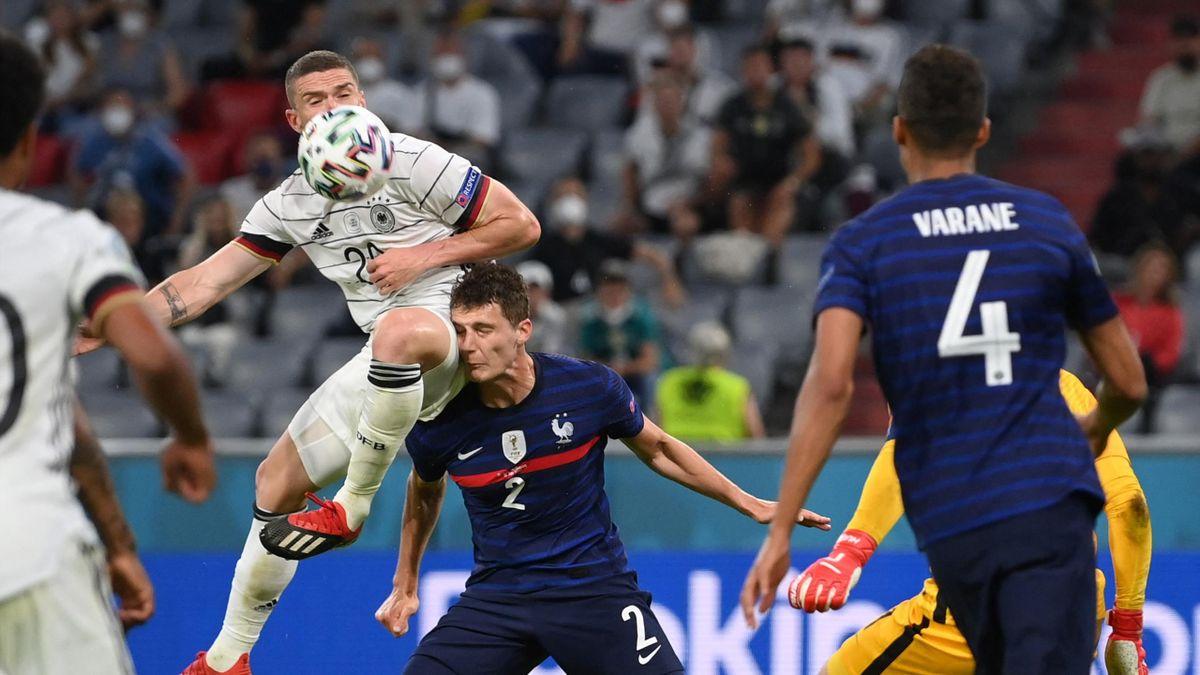 Germany's defender Robin Gosens (L) collides with France's defender Benjamin Pavard