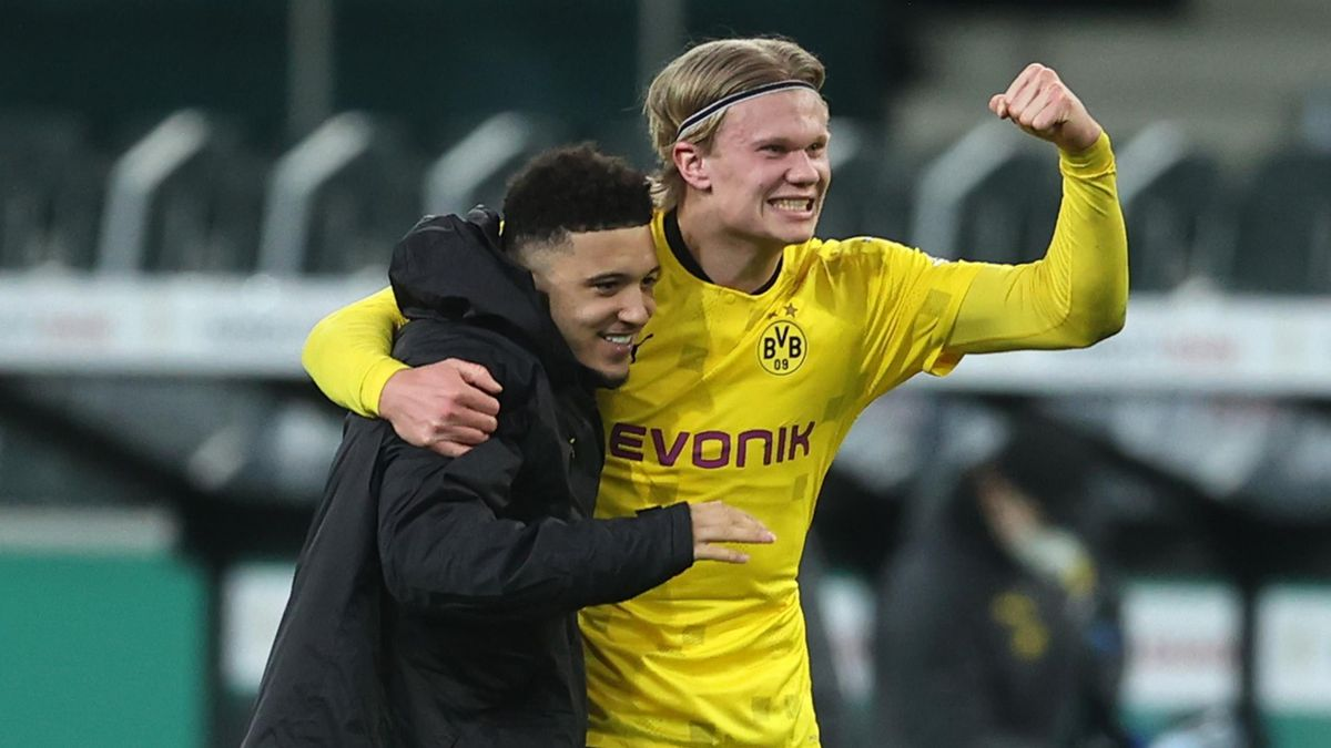Jadon Sancho (L) and Erling Haaland celebrate