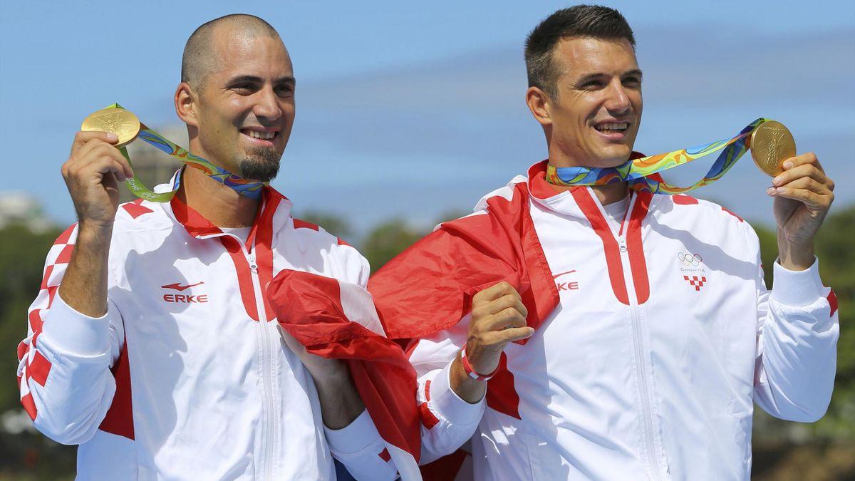 Gold medalists Martin Sinkovic (CRO) of Croatia and Valent Sinkovic (CRO) of Croatia pose with their medals.