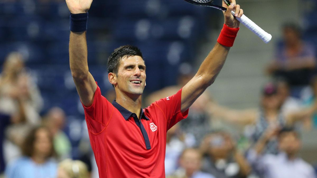 Novak Djokovic of Serbia waves to the crowd after defeating Andreas Haider-Maurer of Austria on day three of the 2015 U.S. Open