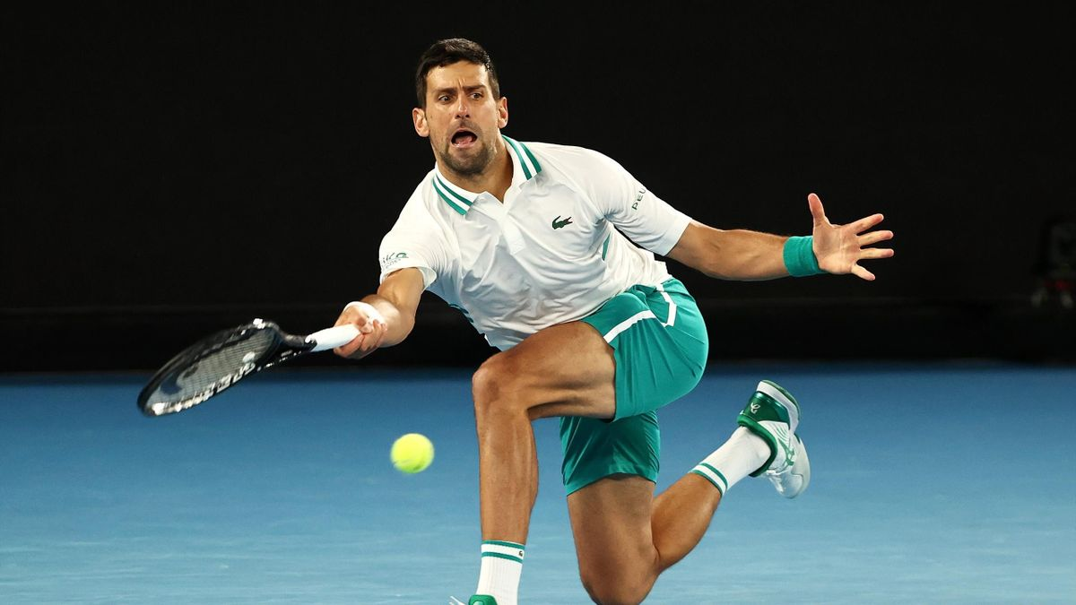 Novak Djokovic of Serbia plays a forehand in his Men's Singles fourth round match against Milos Raonic of Canada