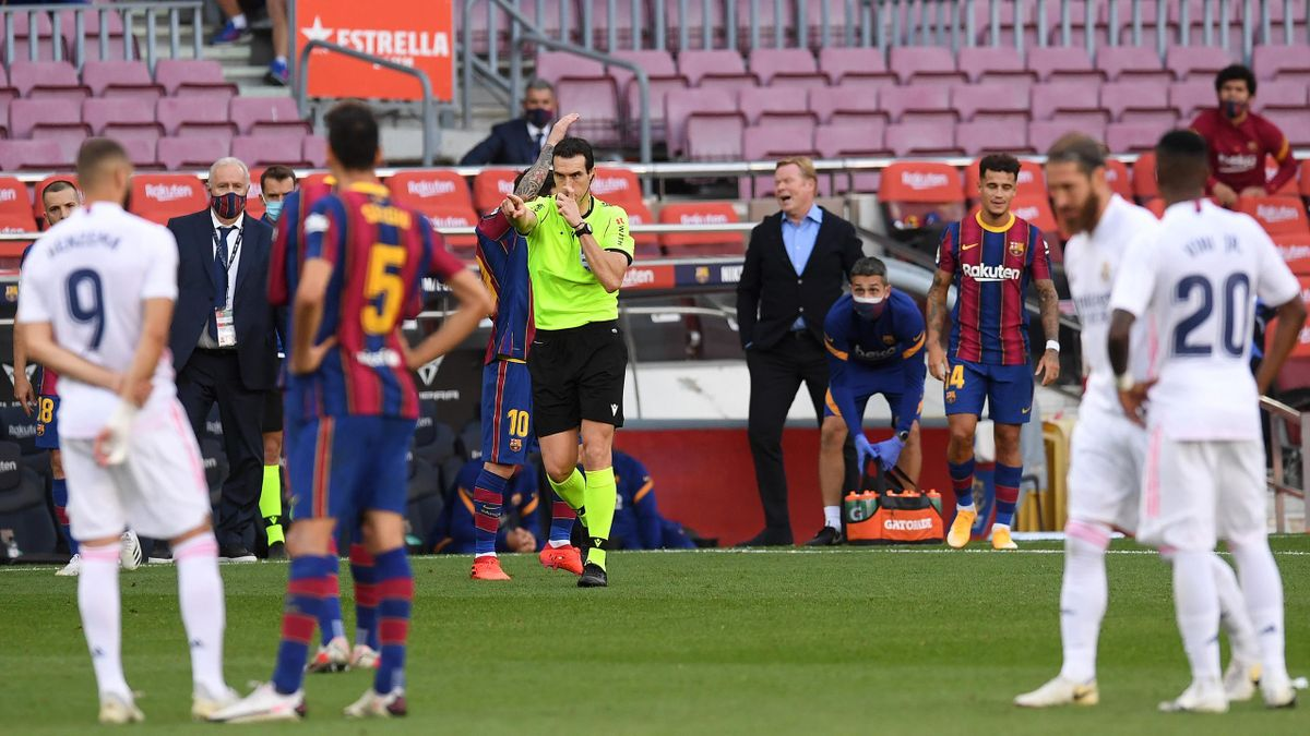 Referee Juan Martinez Munuera awards Real Madrid a penalty following a VAR review during the La Liga Santander match between FC Barcelona and Real Madrid at Camp Nou on October 24, 2020 in Barcelona, Spain.