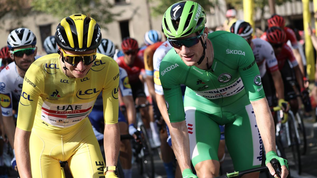 Team UAE Emirates rider Slovenia's Tadej Pogacar wearing the overall leader's yellow jersey rides with Team Deceuninck rider Ireland's Sam Bennett wearing the best sprinter's green jersey during the 21st and last stage of the 107th edition of the Tour de