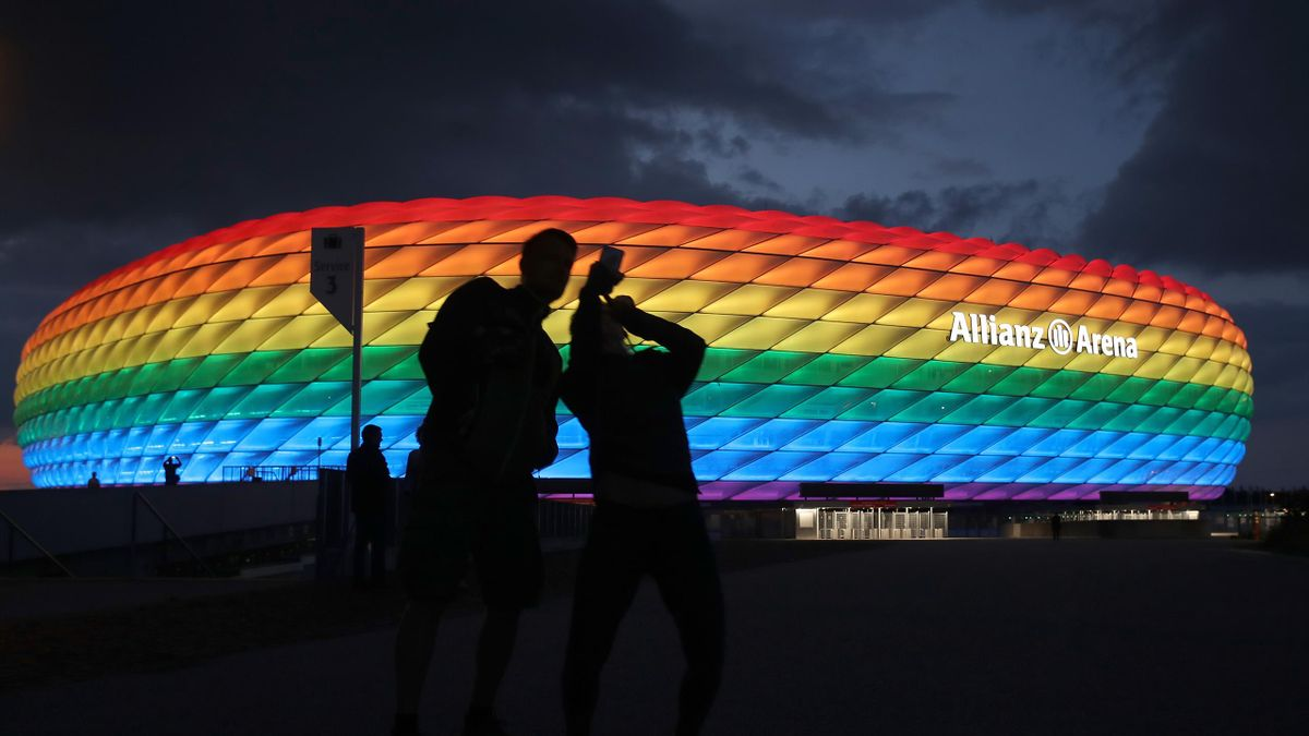 A general view outside of the soccer stadium Allianz Arena which is illuminated in rainbow colours