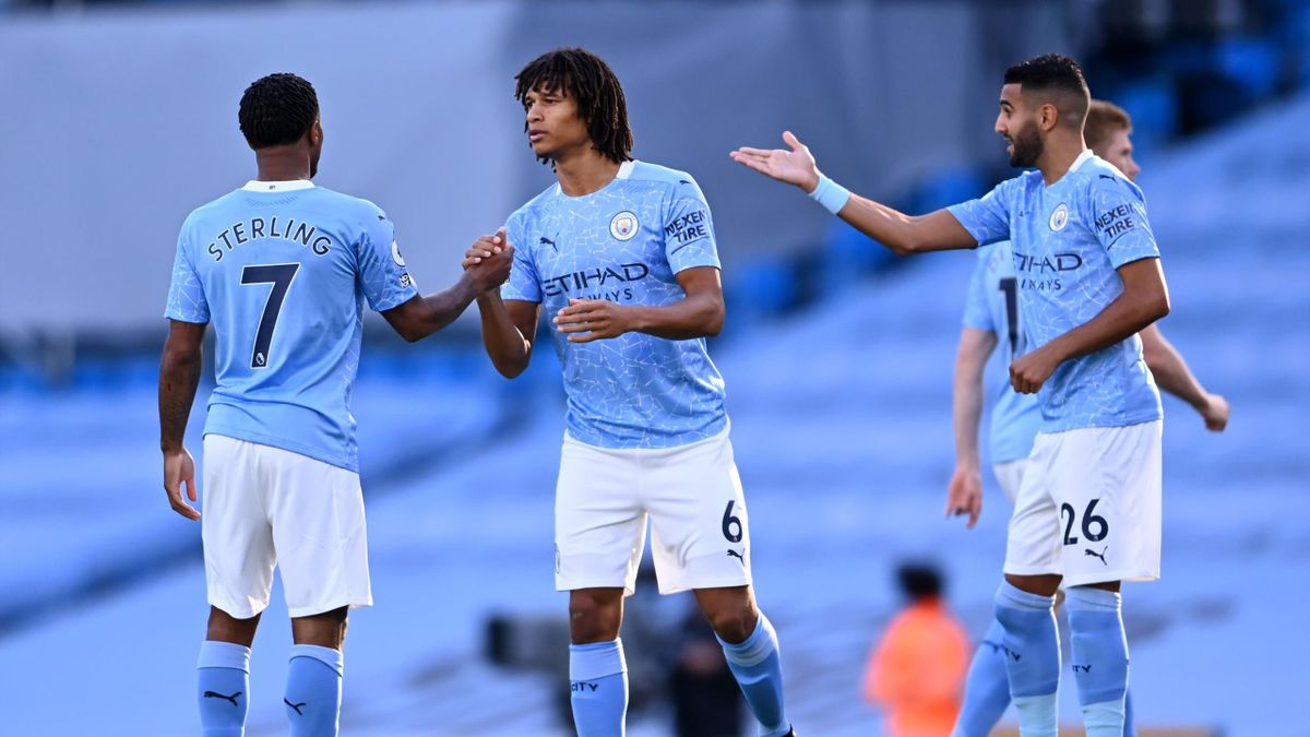 Nathan Ake of Manchester City shakes hands with teammate Raheem Sterling