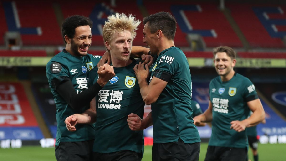 Ben Mee of Burnley celebrates with Jack Cork and Dwight McNeil after scoring his team's first goal during the Premier League match between Crystal Palace and Burnley FC at Selhurst Park on June 29, 2020 in London, United Kingdom