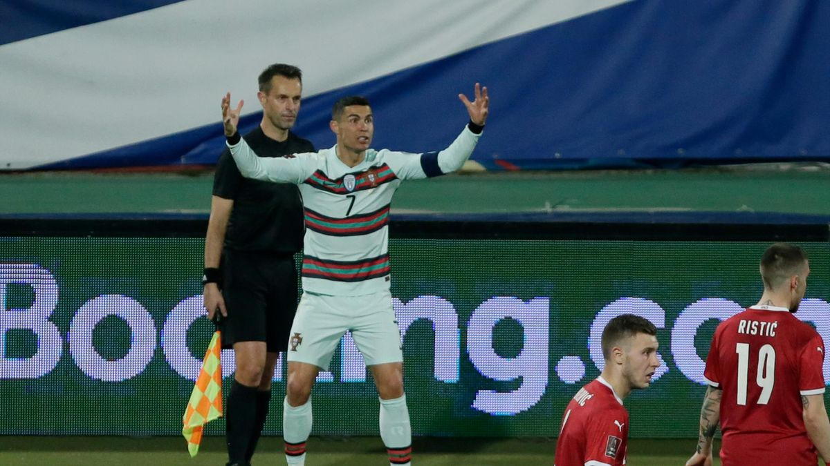 Cristiano Ronaldo of Portugal furious at Assistant referee Mario Diks Portugal robbed last minute goal clearly over the line during the World Cup Qualifier match between Serbia v Portugal at the Stadion Rajko Mitic on March 27, 2021 in Belgrade Serbia
