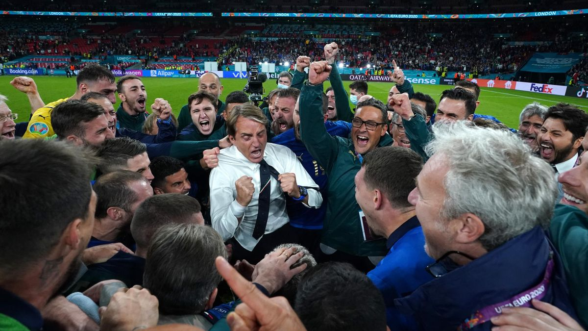 Head coach Italy Roberto Mancini (C) celebrates at the end of the UEFA Euro 2020 Championship Semi-final match between Italy and Spain at Wembley Stadium