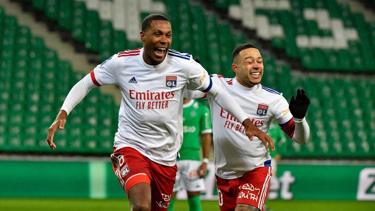 Lyon's Memphis Depay (R) and Marcelo celebrate