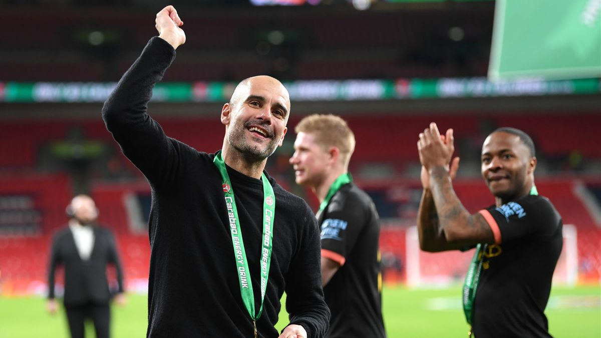 Pep Guardiola celebrates with his Manchester City players