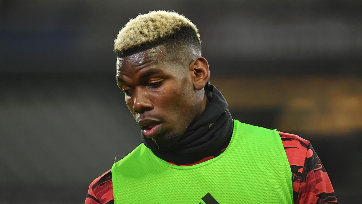 Paul Pogba of Manchester United warms up prior to the Premier League match between West Ham United and Manchester United