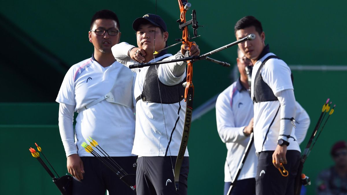 South Korea's Lee Seungyun (C) shoots an arrow during the Rio 2016 Olympic Games men's team semi-final match against Australia
