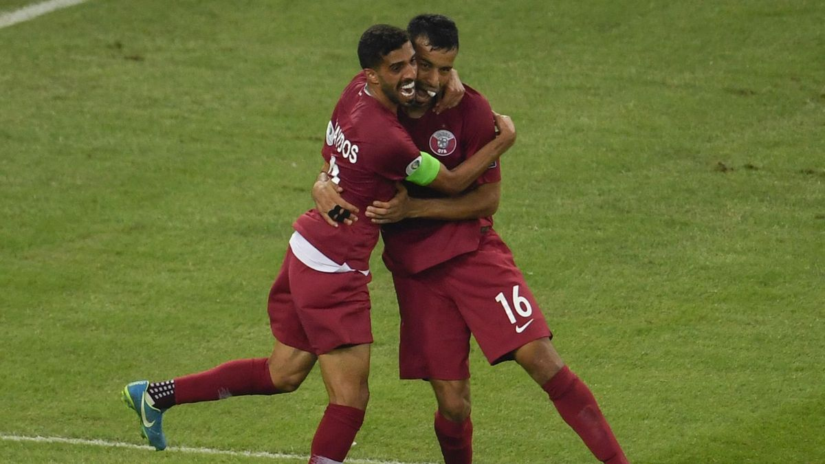 Qatar's Boualem Khoukhi (R) celebrates with teammate Hassan Al-Haydos after scoring against Paraguay during their Copa America football tournament group match at Maracana Stadium in Rio de Janeiro, Brazil, on June 16, 2019.