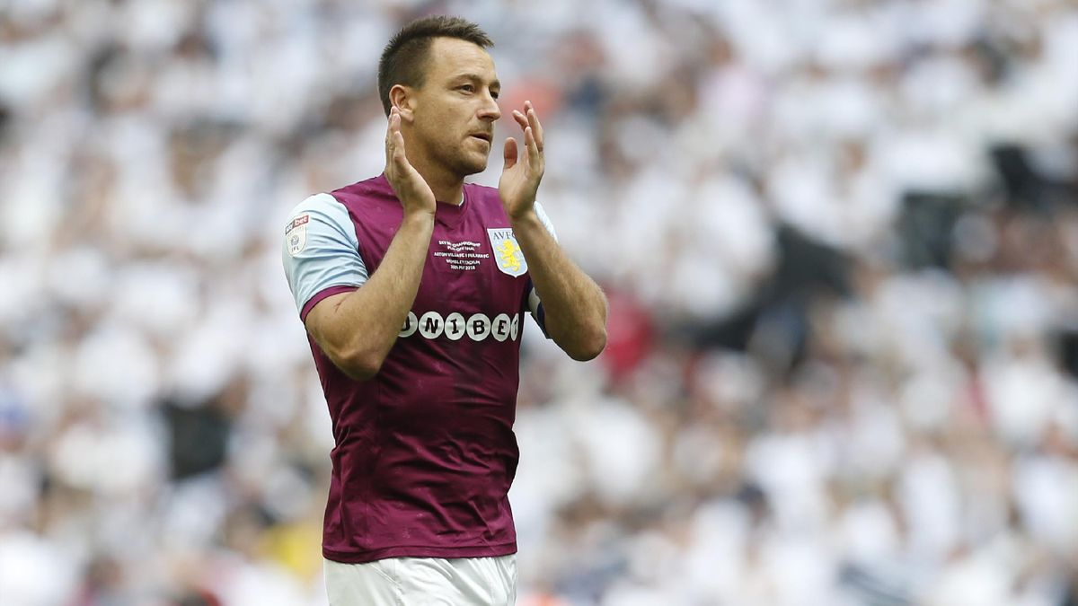 Aston Villa's English defender John Terry applauds their supporters ahead of kick off in the English Championship play-off final football match between Aston Villa and Fulham at Wembley Stadium in London on May 26, 2018.
