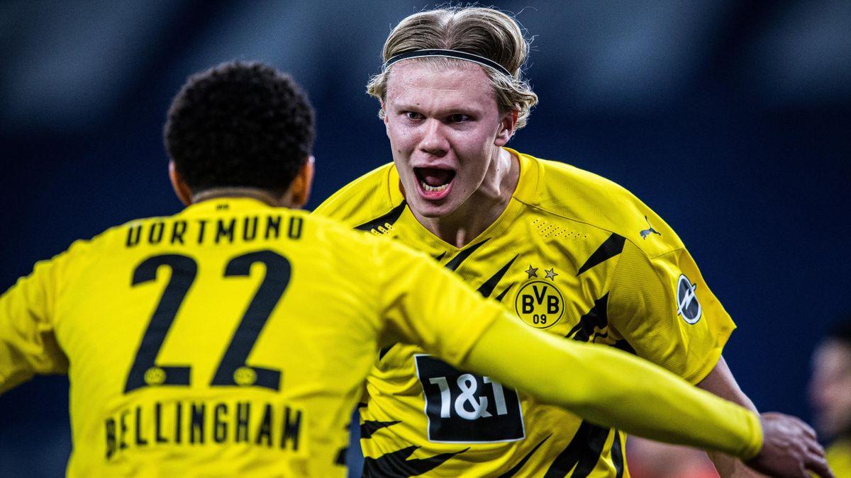 Scorer Erling Haaland (R) of Dortmund celebrates his teams fourth goal with Jude Bellingham (L) during the Bundesliga match between FC Schalke 04 and Borussia Dortmund at Veltins-Arena