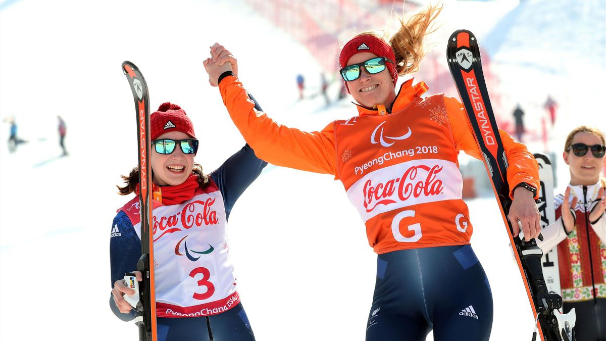 Menna Fitzpatrick of Great Britain celebrates with her guide Jennifer Kehoe at the victoey ceremony in the Alpine Skiing - Women's Super Combined, Visually Impaired during day four of the PyeongChang 2018 Paralympic Games on March 13, 2018 in Pyeongchang-