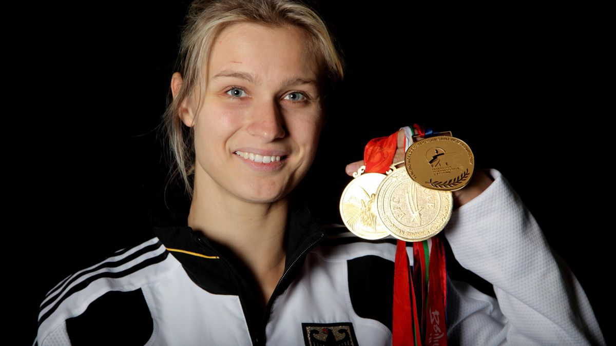 Britta Heidemann mit ihren drei Goldmedaillen
