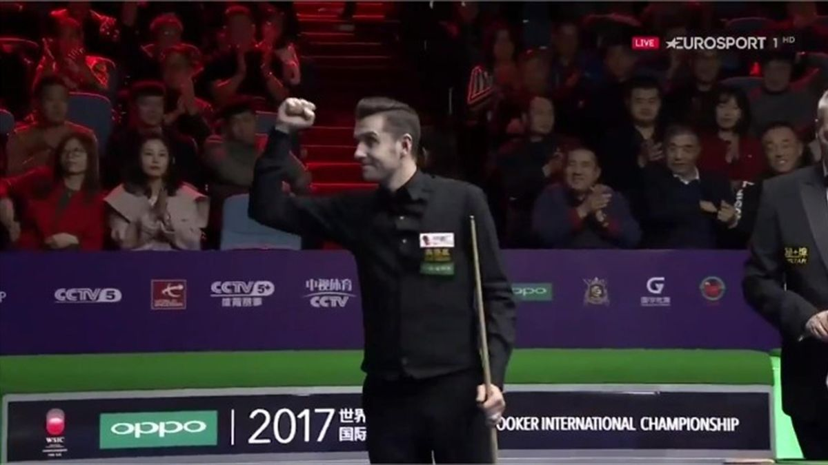 Mark Selby celebrates winning the International Championship title