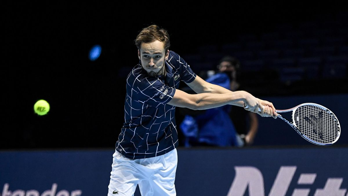 Daniil Medvedev of Russia hits a backhand