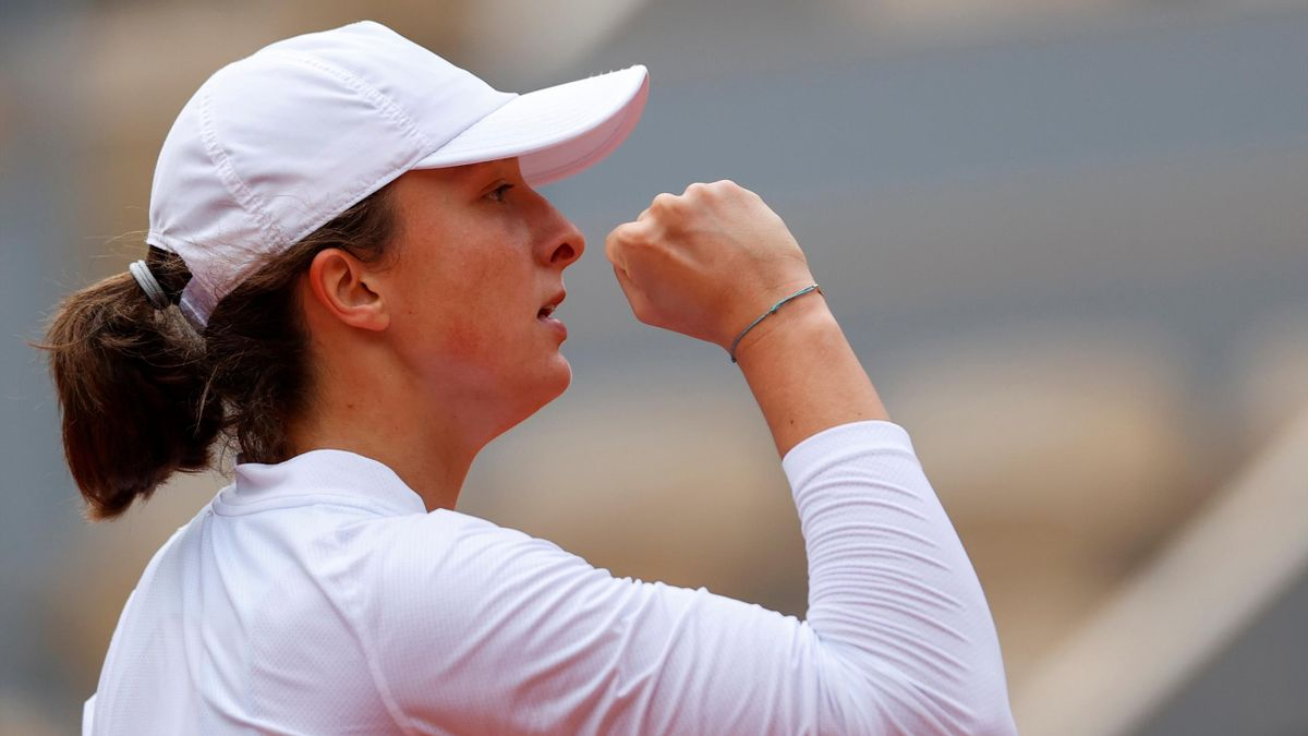 Poland's Iga Swiatek reacts after winning a point against Argentina's Nadia Podoroska during their women's singles semi-final tennis match on Day 12 at Roland Garros