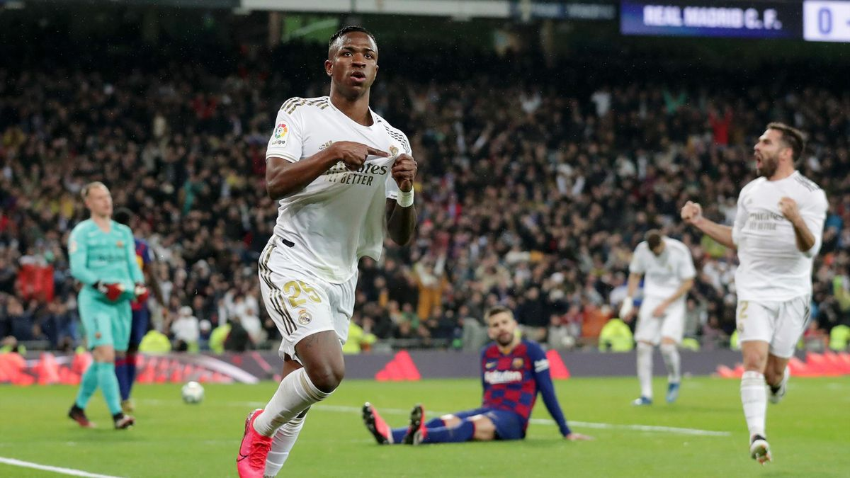 Vinicius Junior of Real Madrid celebrates after scoring his team's first goal during the Liga match between Real Madrid CF and FC Barcelona at Estadio Santiago Bernabeu on March 01, 2020 in Madrid, Spain