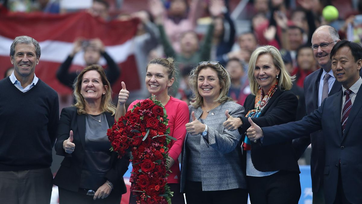 Simona Halep of Romania poses with a bouquet after becoming world number one