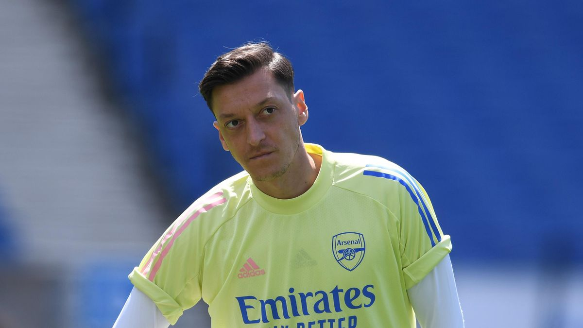 Arsenal substitute Mesut Ozil before the Premier League match between Brighton & Hove Albion and Arsenal FC at American Express Community Stadium on June 20, 2020 in Brighton, England.