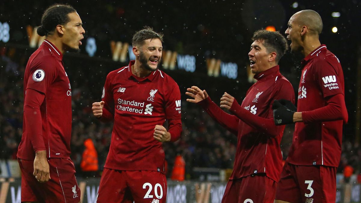 Liverpool's Dutch defender Virgil van Dijk (L) celebrates with Liverpool's English midfielder Adam Lallana (2nd L), Liverpool's Brazilian midfielder Roberto Firmino (2nd R) and Liverpool's Brazilian midfielder Fabinho (R) after scoring their second goal