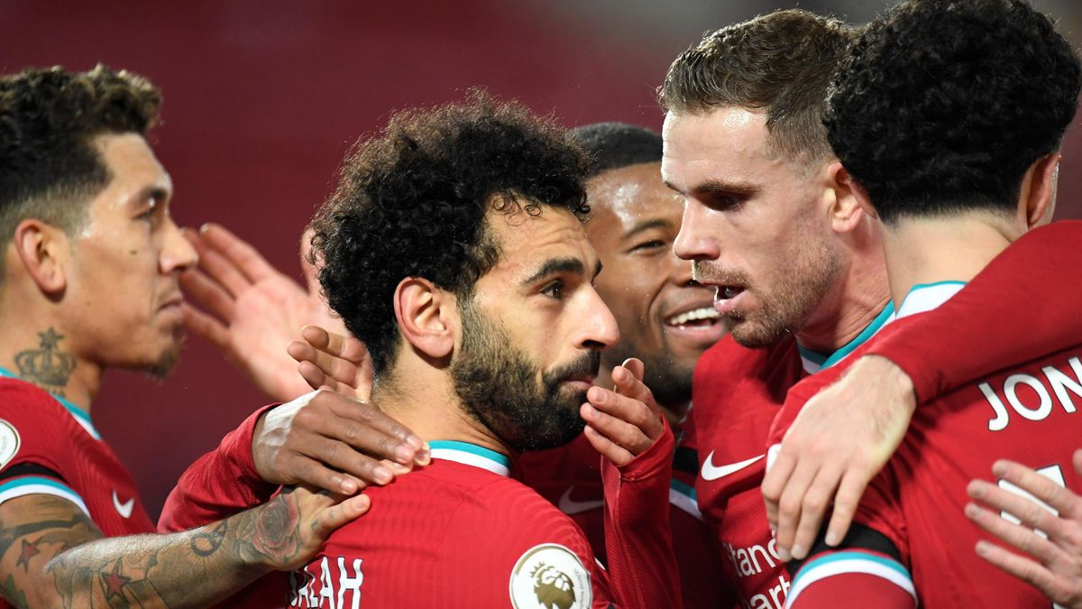 Liverpool's Egyptian midfielder Mohamed Salah (C) is mobbed by teammates after scoring the opening goal during the English Premier League football match between Liverpool and Tottenham Hotspur at Anfield in Liverpool, north west England on December 16, 20