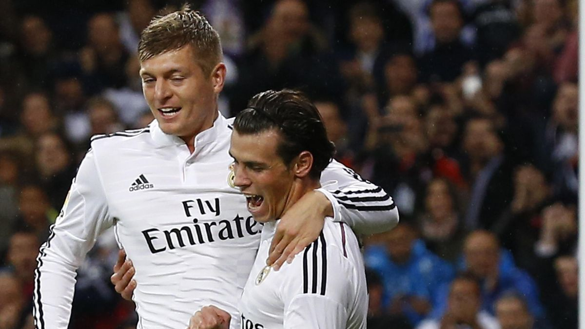Real Madrid's Gareth Bale (R) celebrates his goal against Rayo Vallecano with teammate Toni Kroos during their Spanish first division soccer match at Santiago Bernabeu stadium in Madrid November 8, 2014 (Reuters)