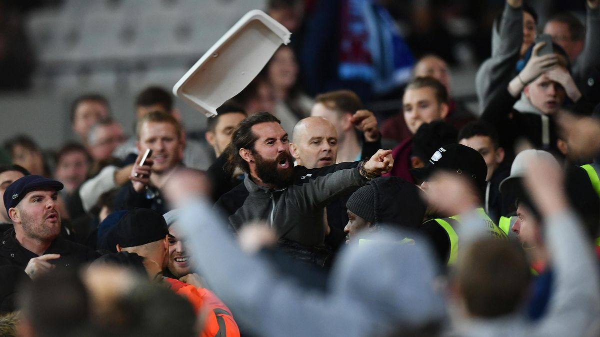 West Ham United and Chelsea fans clash during the EFL Cup fourth round match between West Ham United and Chelsea at The London Stadium on October 26, 2016 in London, England.