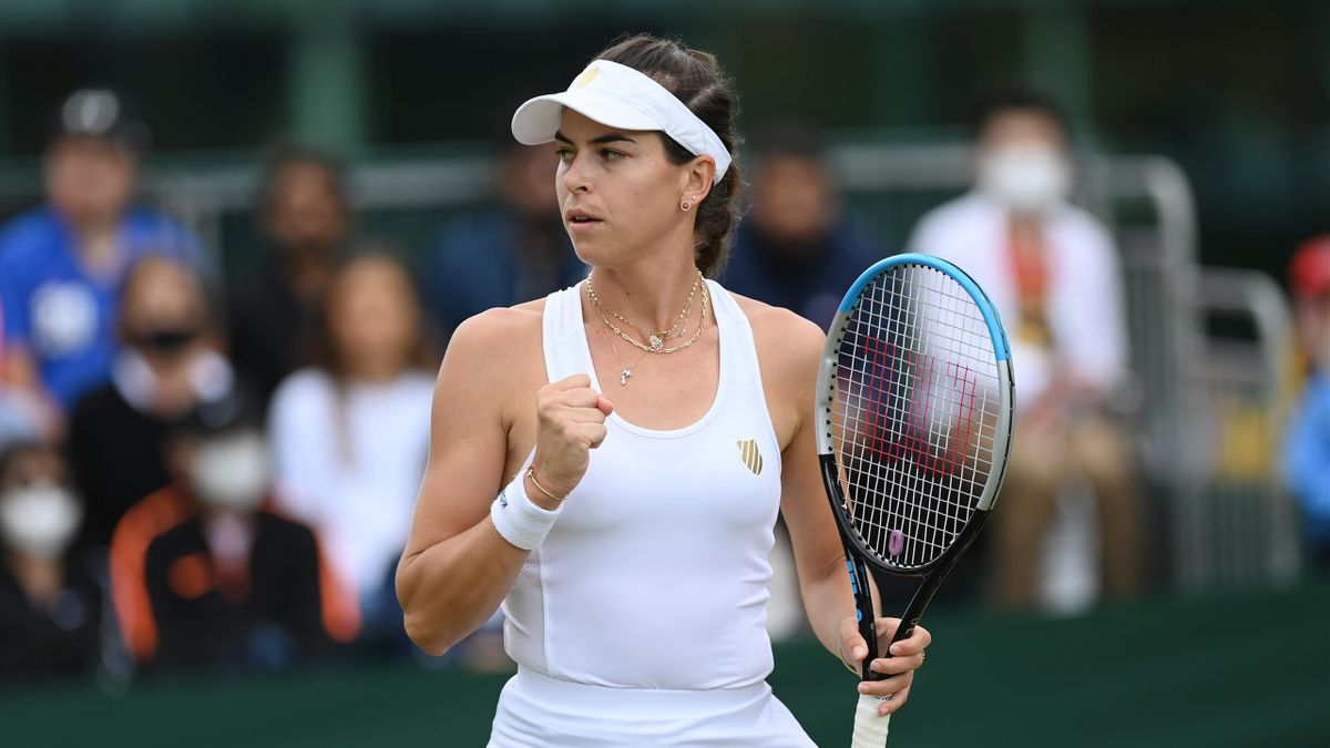 Ajla Tomljanovic of Australia reacts during her Ladies' Singles third Round match against Jelena Ostapenko of Latvia during Day Six of The Championships - Wimbledon 2021