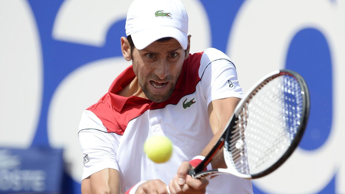 Serbia's Novak Djokovic returns the ball to Slovakia's Martin Klizan during their Barcelona Open ATP tournament