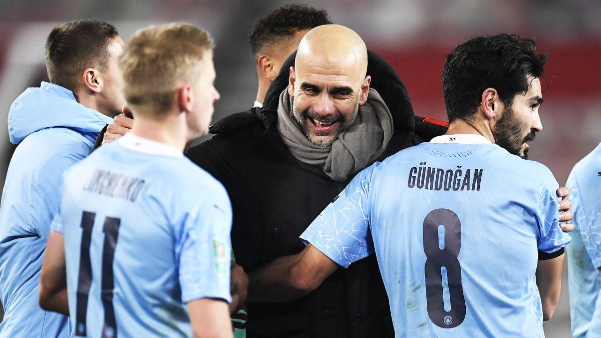 Pep Guardiola mit seinen Spielern von Manchester City