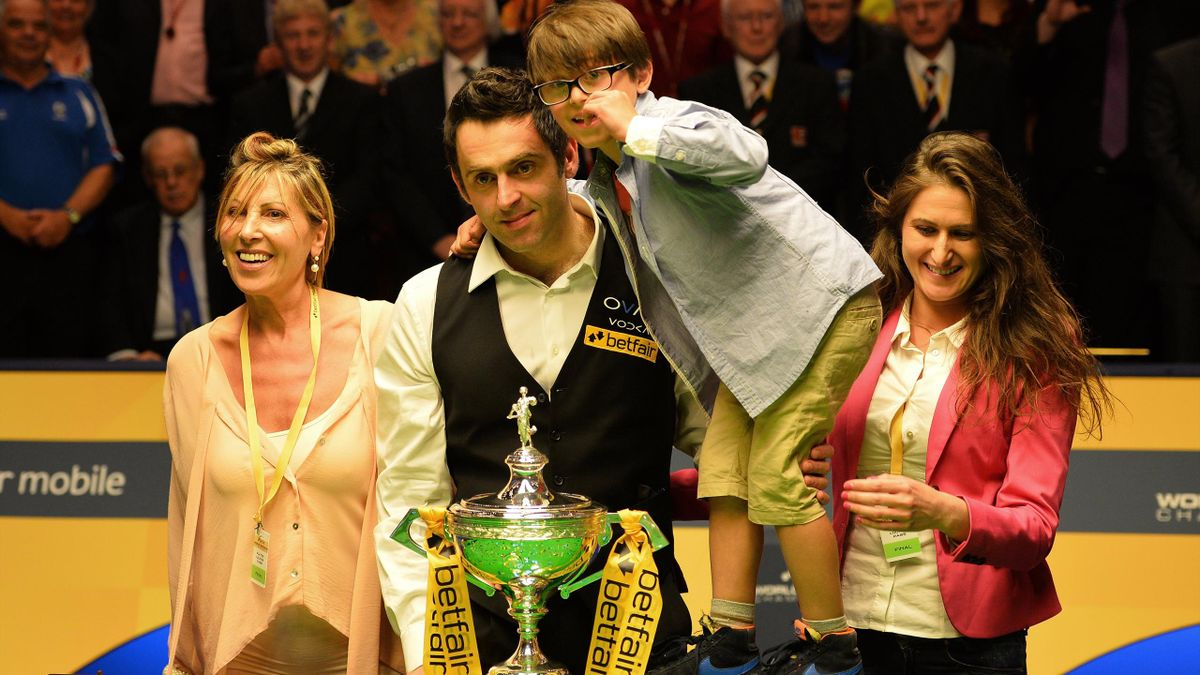 Ronnie O'Sullivan with his mother Maria (L), son Ronnie (2-R) and sister Danielle after winnning the world title in 2013.